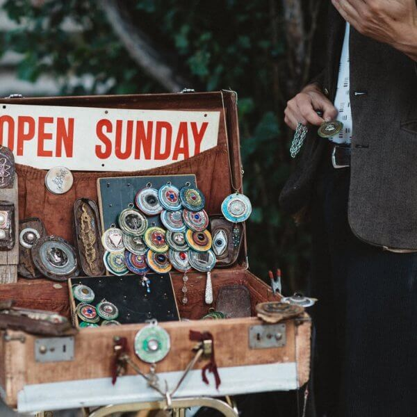 A suitcase full of equipment has a sign that reads open sunday. You need more than this to ace your web content marketing