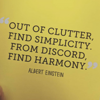 Quote on a yellow page in black writing sums up the Unashamedly Creative content creation process- out of clutter, find simplicity. From discord, find harmony. Albert Einstein