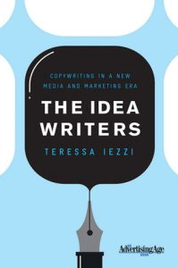 Cover art of the book The Idea Writers by Teress Iezzi - it features the words on a black ink blot coming from an old fashioned quill pen. Behind it is a light blue background that sort of looks like an hour glass but more modern