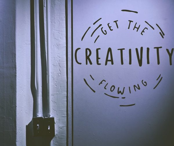 A sign etched on the wall reads let the creativity flow. It's in a circle.